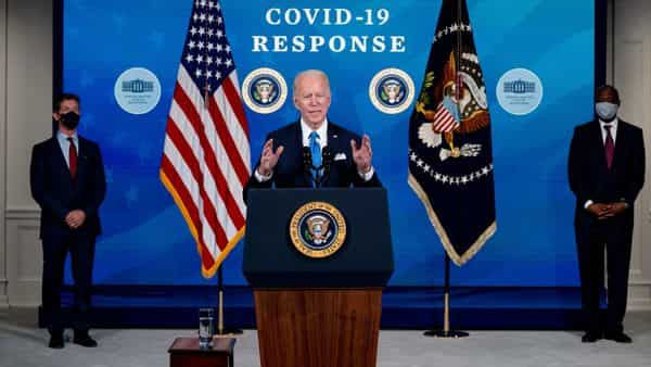 President Joe Biden, accompanied by Johnson and Johnson Chairman and CEO Alex Gorsky, left, and Merck Chairman and CEO Kenneth Frazier, right (AP)