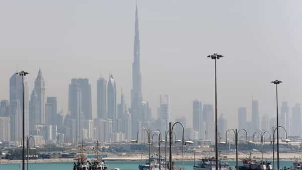 The skyline is seen with the Burj Khalifa as ships dock at Port Rashid (REUTERS)