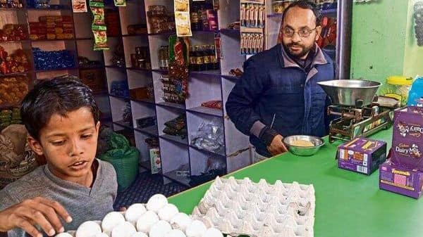 Mohammed Imran, a former migrant, now runs a grocery store in Araria, Bihar, and makes half of what he earned as a skilled embroidery worker (Photo: Sayantan Bera )