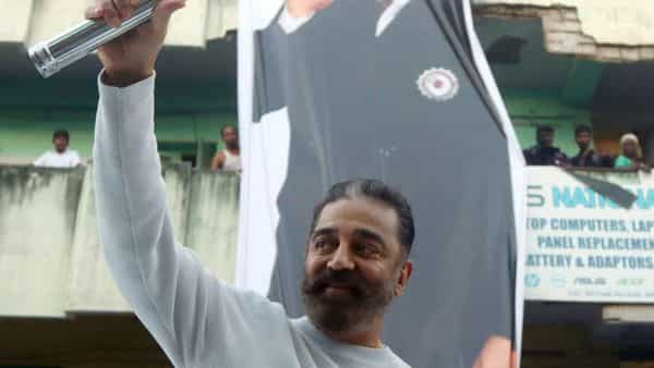Makkal Needhi Maiam President Kamal Haasan shows the party's election symbol 'Torch' during a campaign ahead of the assembly election, in Chennai on Friday. (ANI Photo)