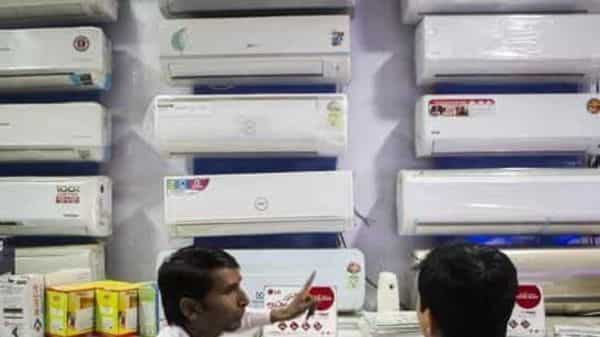 Consumer durables such as washing machines, refrigerators and microwave ovens were earlier placed under the 28% tax slab, which was recently reduced to 18%. Photo: Bloomberg