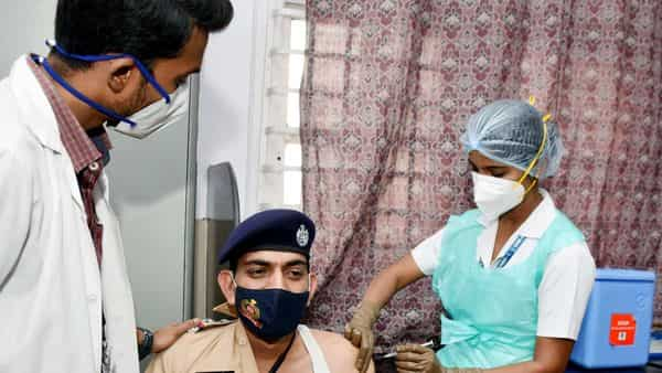 A medical staff at Cama hospital injects a COVID-19 vaccine to police personnel, in Mumbai on Saturday.  (ANI)