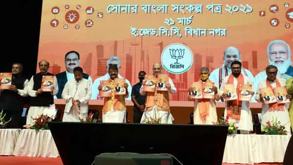 Union Home Minister Amit Shah releases BJP Manifesto of West Bengal election, in Kolkata on Sunday. (ANI Photo)