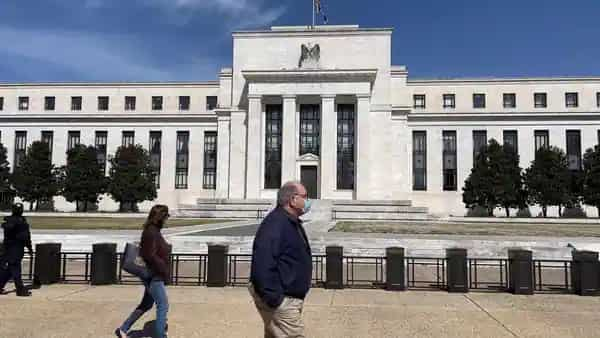 People walk past the US Federal Reserve building in Washington, DC (AFP)