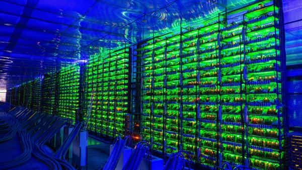 Illuminated mining rigs operate inside racks at the CryptoUniverse cryptocurrency mining farm in Nadvoitsy, Russia, on Thursday, March 18, 2021. The rise of Bitcoin and other cryptocurrencies has prompted the greatest push yet among central banks to develop their�own digital currencies. Photographer: Andrey Rudakov/Bloomberg (Bloomberg)
