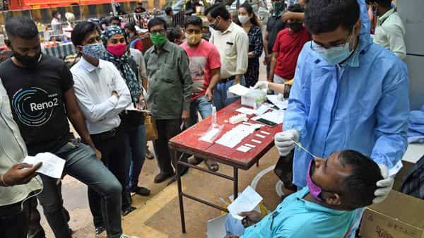 A health worker conducts antigen tests for people who visit the mall at Dadar in Mumbai. (ANI Photo)