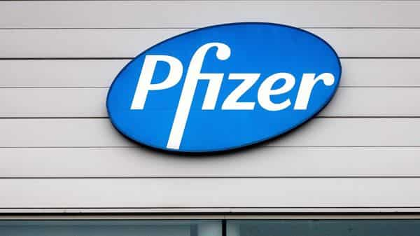 A sign in the window of an office at Pfizer Manufacturing in Puurs, Belgium (AP)