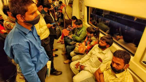 Heavy rush of commuters seen inside a Delhi Metro coach in clear violation of Covid-19 protocol, at Rajiv Chowk, in New Delhi