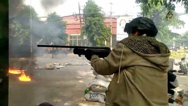 A protester fires a homemade air gun during a protest against the military coup, in Mandalay, Myanmar March 27, 2021 in this still image taken from video obtained by Reuters. (via REUTERS)