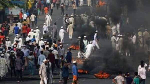 Activists of Bangladesh Islamist group Hefazat-e-Islam, burn tires to block traffic on the Dhaka Chittagong high way as they enforce a daylong general strike in Narayanganj, Bangladesh.  (AP)