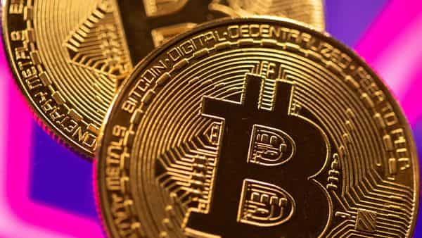 FILE PHOTO: A representation of virtual currency Bitcoin is seen in front of a stock graph in this illustration. (REUTERS)