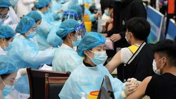 Medical workers inoculate students with the vaccine against the coronavirus disease (COVID-19) at a university in Qingdao, Shandong province, China March 30, 2021. Picture taken March 30, 2021. China Daily via REUTERS (VIA REUTERS)