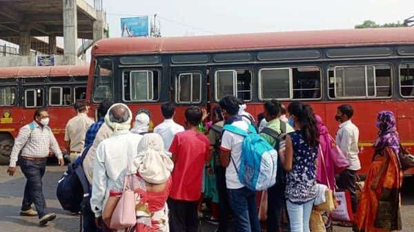 Passengers violate social distancing norms at a bus station in Nagpur on Wednesday, March 17. (ANI) (HT_PRINT)