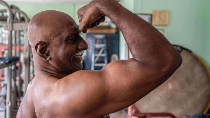 Bodybuilder A. Arokiasamy flexes his biceps after training at his gymnasium in Teluk Intan in Malaysia's Perak state.