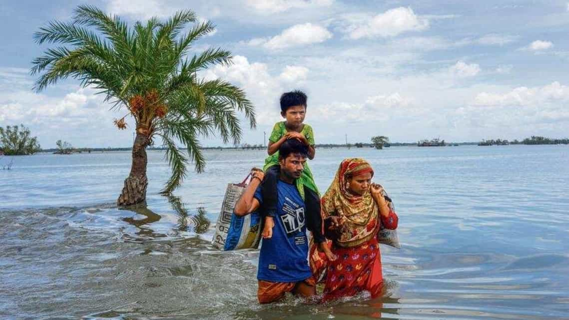 Large parts of the Sunderbans flooded in 2020 after cyclone Amphan, causing families to leave their villages.