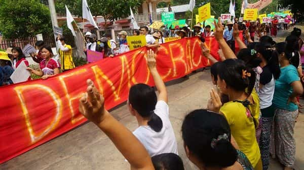 People taking part in a demonstration against the military coup in Win Yay township, in eastern Myanmar's Karen state (AFP)