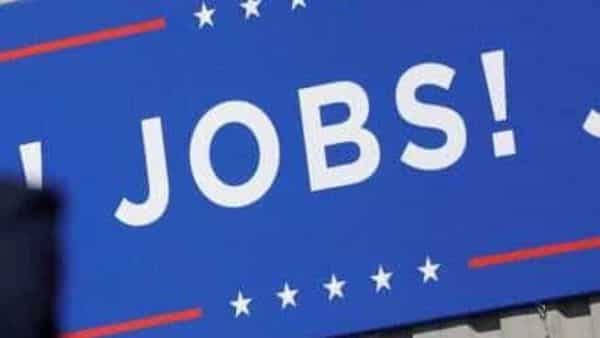US President Donald Trump speaks in front of a 'JOBS JOBS JOBS' banner at a Trump re-election campaign event. (REUTERS)