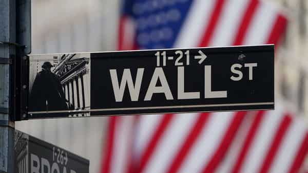 FILE PHOTO: The Wall Street sign is pictured at the New York Stock exchange (NYSE) in the Manhattan borough of New York City, New York, U.S.  (REUTERS)