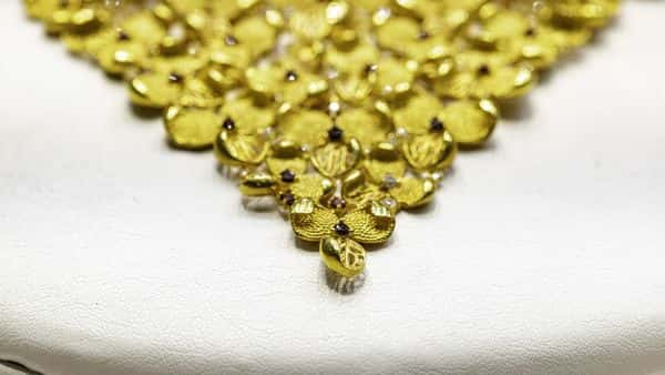 Gold jewellery on display in a shop window  (Bloomberg)