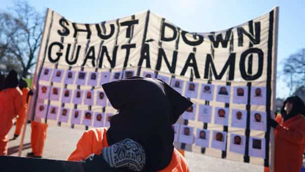 A protest calling for the closure of the Guantanamo Bay prison in front of the White House in Washington, DC (AFP)