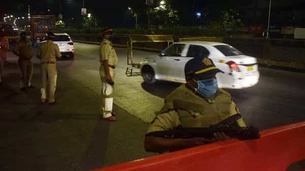 Police personnel stand guard as night curfew was imposed by the Government of Maharashtra at Dadar in Mumbai on Wednesday. (ANI Photo)
