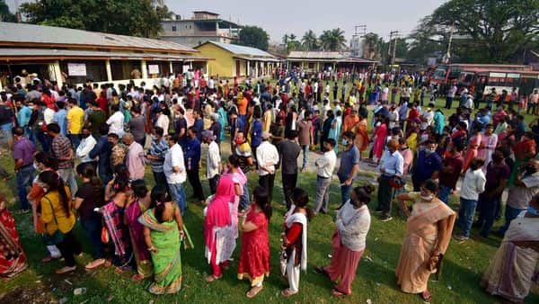 Voters queue up to cast their vote during the third and final phase of Assam Assembly Elections 2021, at a polling station, in Guwahati.