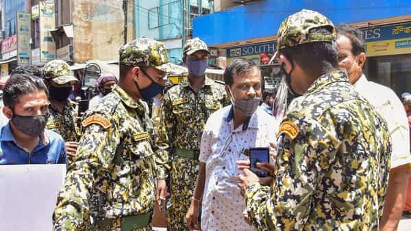 BBMP marshals on duty to ensure people follow COVID-19 guidelines, at a busy market in Bengaluru (PTI)