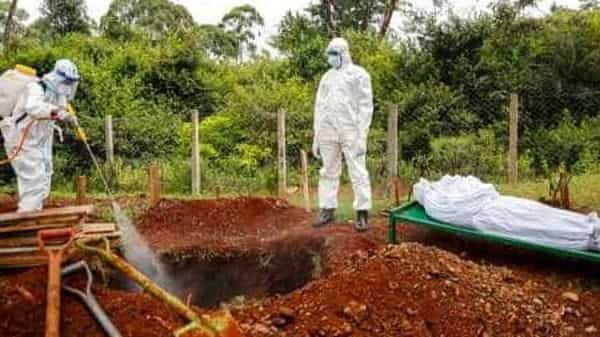 Representational image. Members of a team dedicated to burying  victims of the new coronavirus spray disinfectant into the grave (AP)