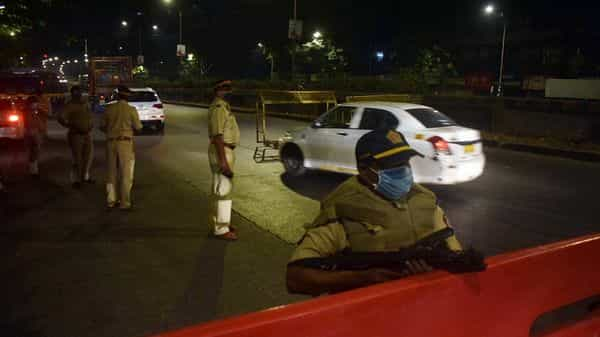 Police personnel stand guard as night curfew was imposed by the Government of Maharashtra at Dadar in Mumbai  (ANI)