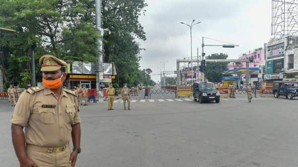 Police personnel stand guard on a street at Hazratganj in Lucknow (PTI)