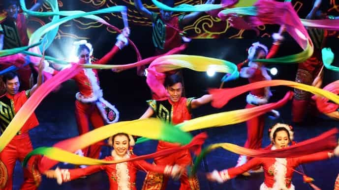 Chinese dancers perform during an event celebrating the Spring Festival to welcome the Lunar New Year of the Dog in Kolkata in 2018. Photo via AFP