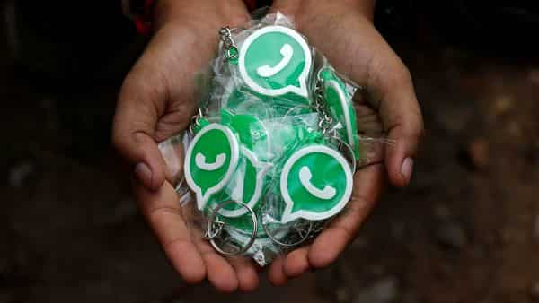 Key chains with the logo of WhatsApp. (REUTERS)