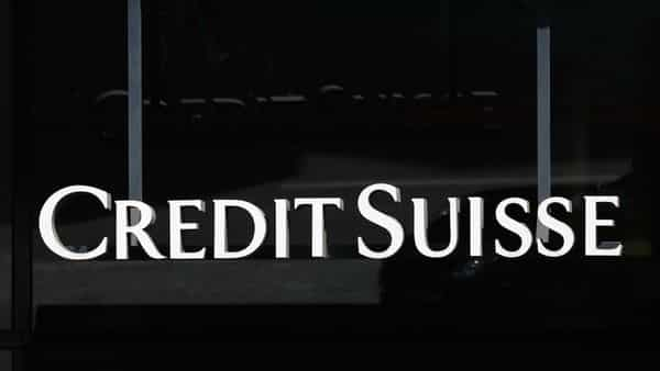 A Credit Suisse logo hangs above an entrance to the Credit Suisse Group AG headquarters in Zurich, Switzerland, on Thursday, April 8, 2021. Credit Suisse Chief Executive Officer�Thomas Gottstein gathered dozens of managing directors at the global bank on a conference call late Tuesday, as part of crisis-management efforts after the lender announced that it stands to lose as much as $4.7 billion amid the meltdown of hedge fund�Archegos Capital Management. Photographer: Stefan Wermuth/Bloomberg (Bloomberg)