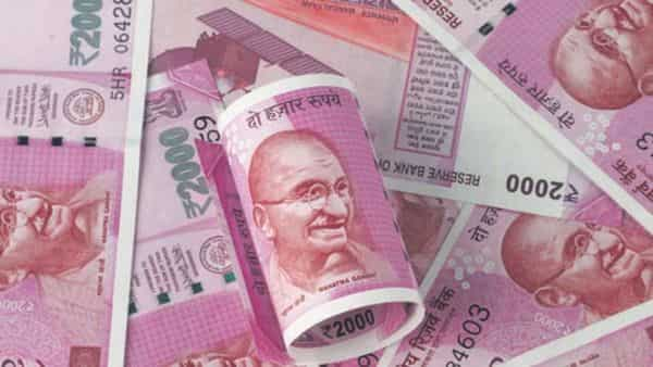 The rupee today edged higher to 74.22 per US dollar