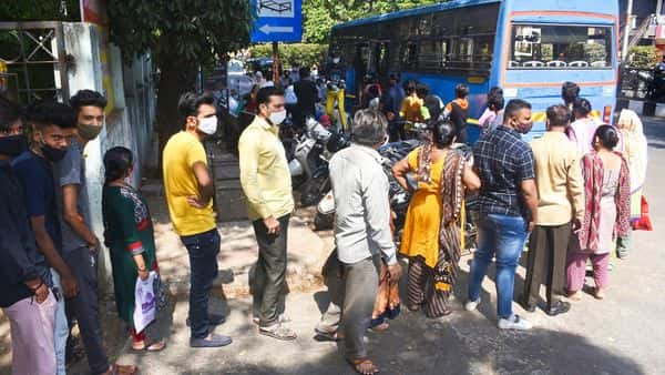 Surat: People wait in queue to collect medicines from 'Arogya Rath', a government initiative, in Surat, Tuesday, April 6, 2021. (PTI Photo)  (PTI04_06_2021_000169B) (PTI)