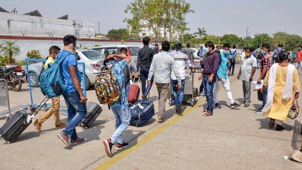 Maharashtra labourers arrive at Birsa Munda International Airport to reach their native places, amid coronavirus pandemic, in Ranchi. (PTI)