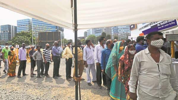 People queue up for vaccination in Mumbai. So far, more than 90 mn Indians above 45 and health workers have received at least one shot.