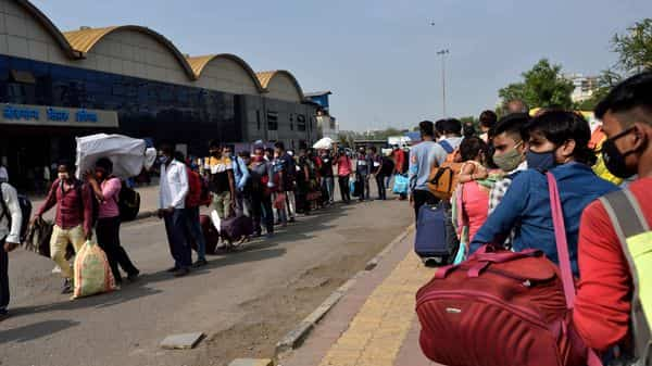 Migrant workers queued outside Lokmanya Tilak Terminus while waiting to board a special train from Mumbai to Uttar Pradesh.
