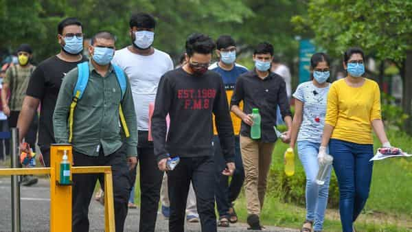 Aspirants come out of an examination centre after appearing in IIT-JEE exams, in Bhopal on 1 September. (PTI)
