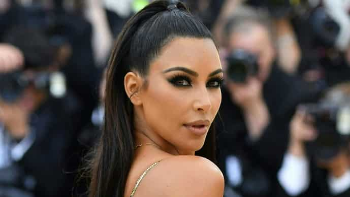 (FILES) In this file photo taken on May 07, 2018 Kim Kardashian arrives for the 2018 Met Gala at the Metropolitan Museum of Art in New York. - Reality television star, influencer and business owner Kim Kardashian West is officially a billionaire, according to an estimate from Forbes, making her debut on the exclusive global list only one year after her younger sister Kylie Jenner fell off of it.  Kardashian West's money comes from TV income and endorsement deals, according to the magazine, as well as her two lifestyle brands. (Photo by Angela WEISS / AFP)