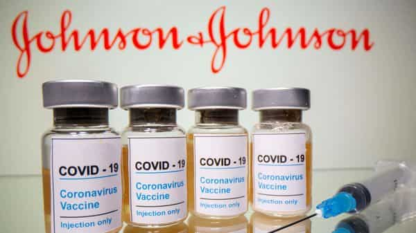 FILE PHOTO: Vials with a sticker reading, 'COVID-19 / Coronavirus vaccine / Injection only' and a medical syringe are seen in front of a displayed Johnson & Johnson logo.  (REUTERS)
