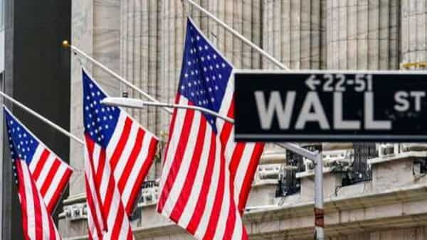 FILE - American flags hang outside of the New York Stock Exchange. (AP)