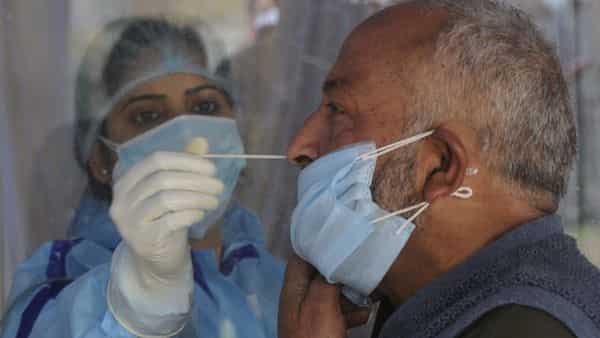 Srinagar,India-April 06: A health worker taking a nasal swab sample from a man to test for Covid-19 at a test center in Srinagar, Jammu and Kashmir, India on Tuesday, April 6, 2021. (Photo by Waseem Andrabi/Hindustan Times)