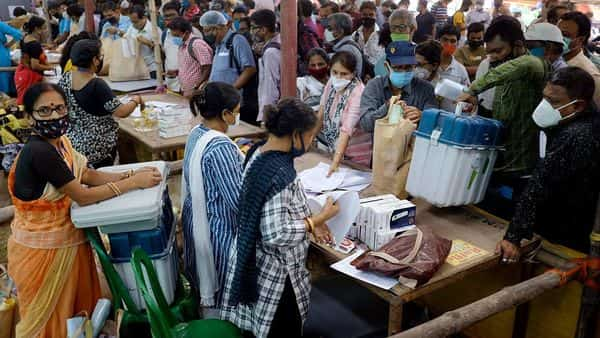 Polling officials collecting EVMs and other polling materials on the eve of the fifth phase of the West Bengal Assembly election, in Panihati on Friday. (ANI Photo)