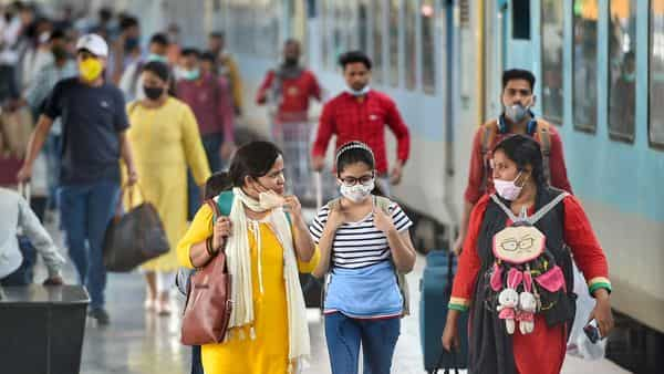 Passengers, wearing masks as per Covid-19 guidelines, arrive at the Charbagh Railway Station amid countrywide spike in coronavirus cases, in Lucknow. (PTI)