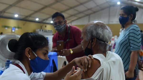 People visits vaccination centre in MMRC Dedicated COVID Health Centre during Maharashtra weekend lockdown imposed amid Covid surge at Ketakipada, Dahisar, in Mumbai, India, on Sunday, April 11, 2021.Photo by Vijay Bate.
