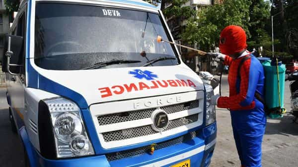 A man dresses up as Spiderman disinfect Ambulance amid Covid-19 pandemic, in Mumbai. (ANI)