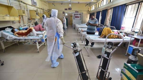 A medical professional in PPE coveralls sorts oxygen cylinders, at ESIC (Indira Gandhi) Hospital Jhilmil, in New Delhi (Raj K Raj/HT PHOTO)
