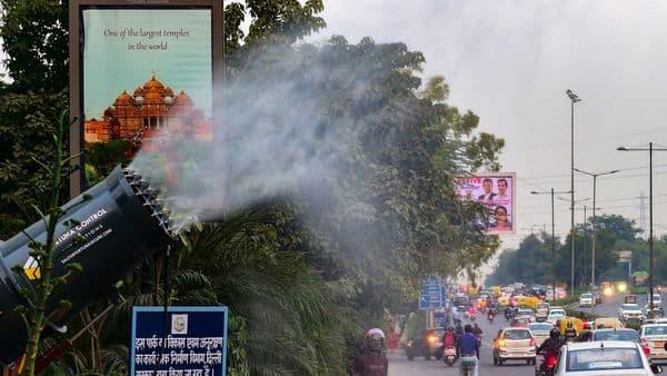 An anti-smog gun sprays water into the air to curb air pollution, in New Delhi. (PTI)