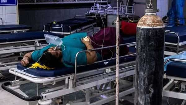 A patient suffering from the coronavirus disease (COVID-19) gets treatment at the casualty ward in Lok Nayak Jai Prakash (LNJP) hospital (REUTERS)